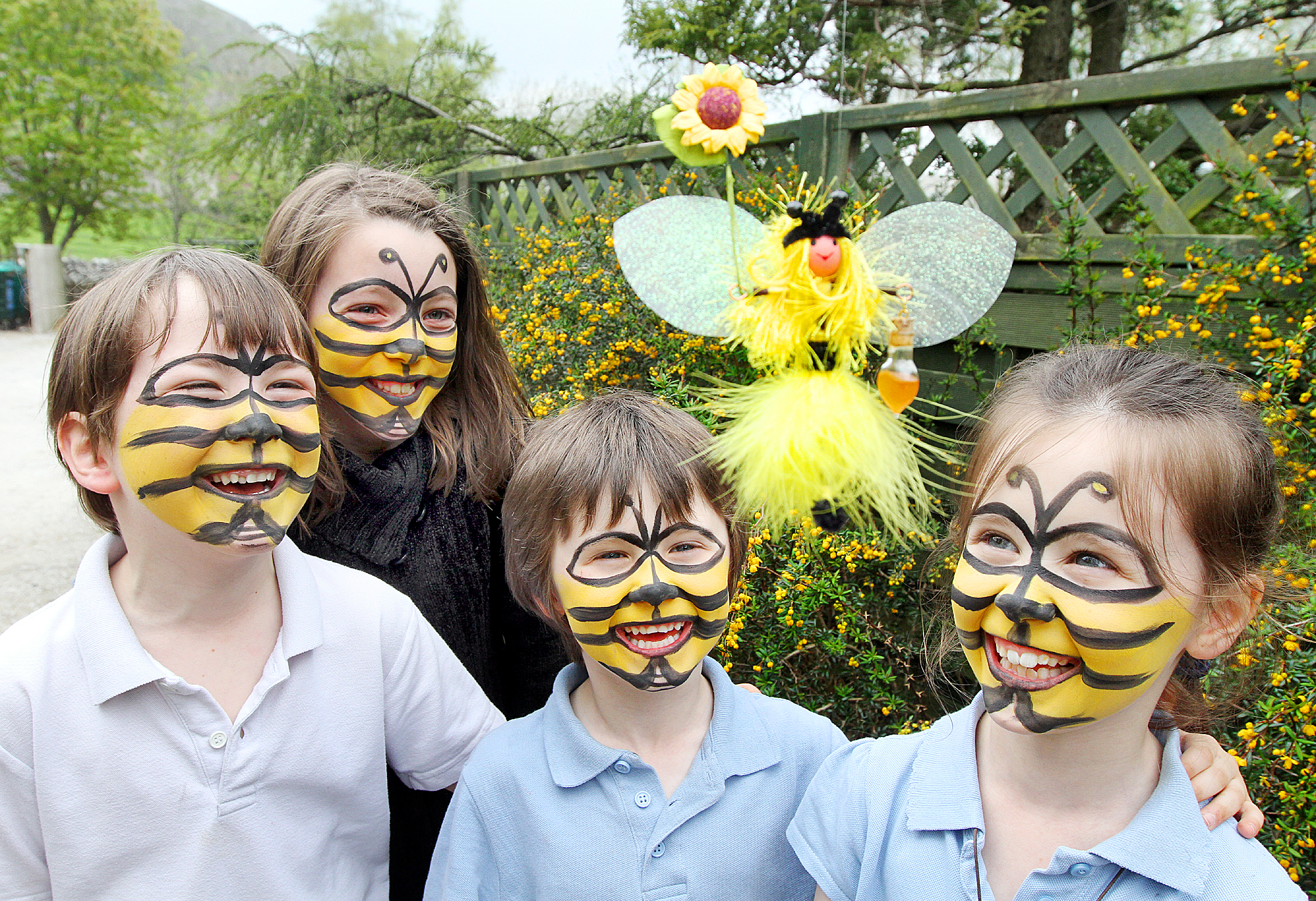 BEE SMART: Lewis Roberts, Ella Shepherd, Oscar McDonough and Courtney McDonough with their face painted as bees for Life is Sweet, a family event at Kilnsey Park where people foun