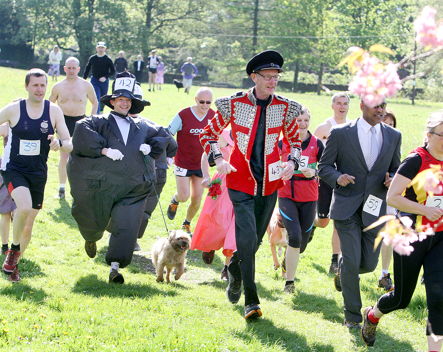 THE RUNAWAY BRIDE: Above, runners in fancy dress taking part
