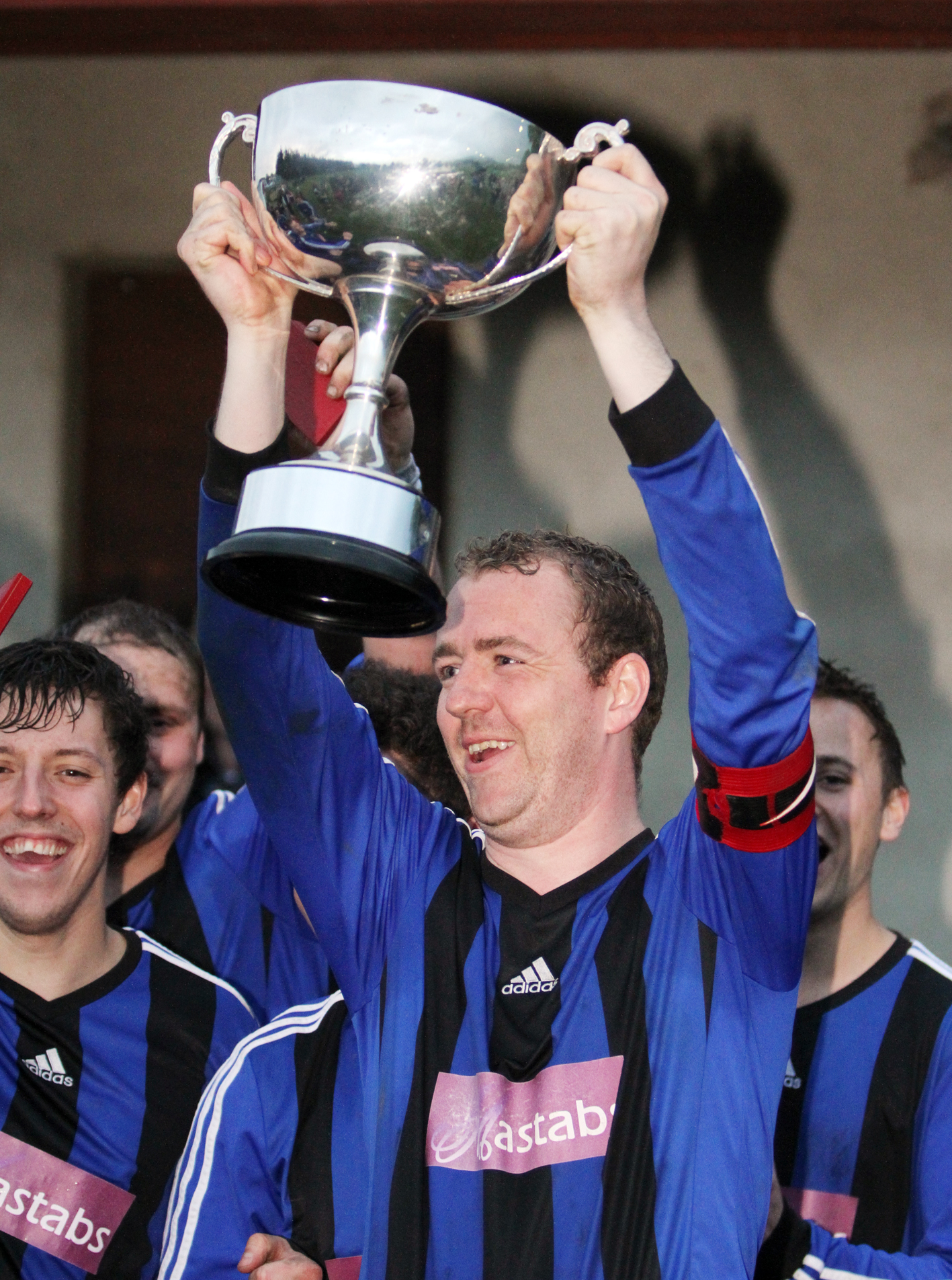 Skipper Ian Craven lifts the League Cup