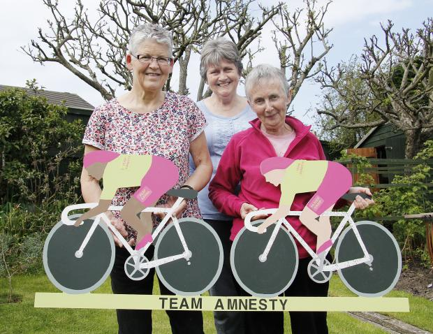 With the Silsden Amnesty bike display are group members, from left, Alison Tribe, Anna Young and June Brennan