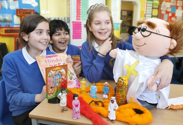 Christ Church Primary School pupils Athina Tazes, Sufyan Khan and Tilly Moorhouse learning about different faiths
