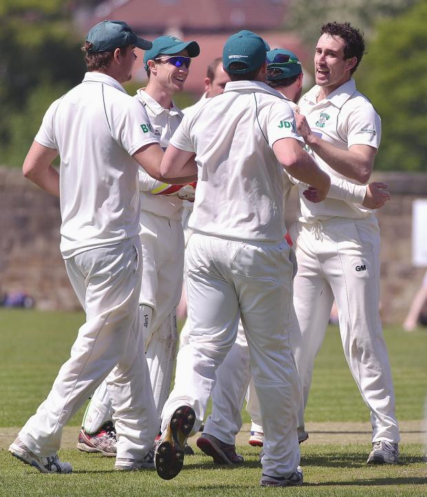 Craven Herald: Otley celebrate last weekend after James Davies takes a wicket against Ilkley