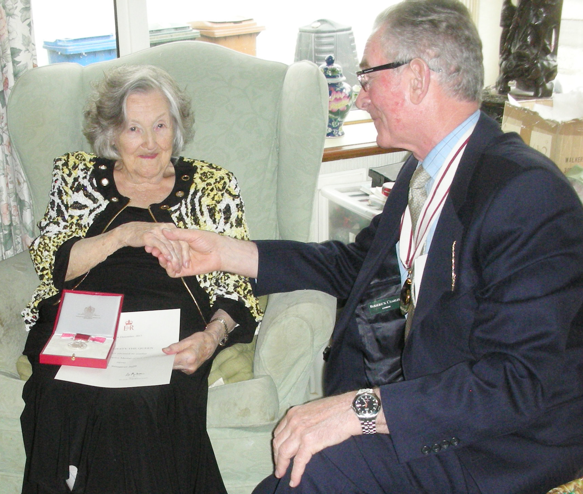 Former dance teacher Margaret Jaffe receives her BEM from Deputy Lieutenant John Henderson