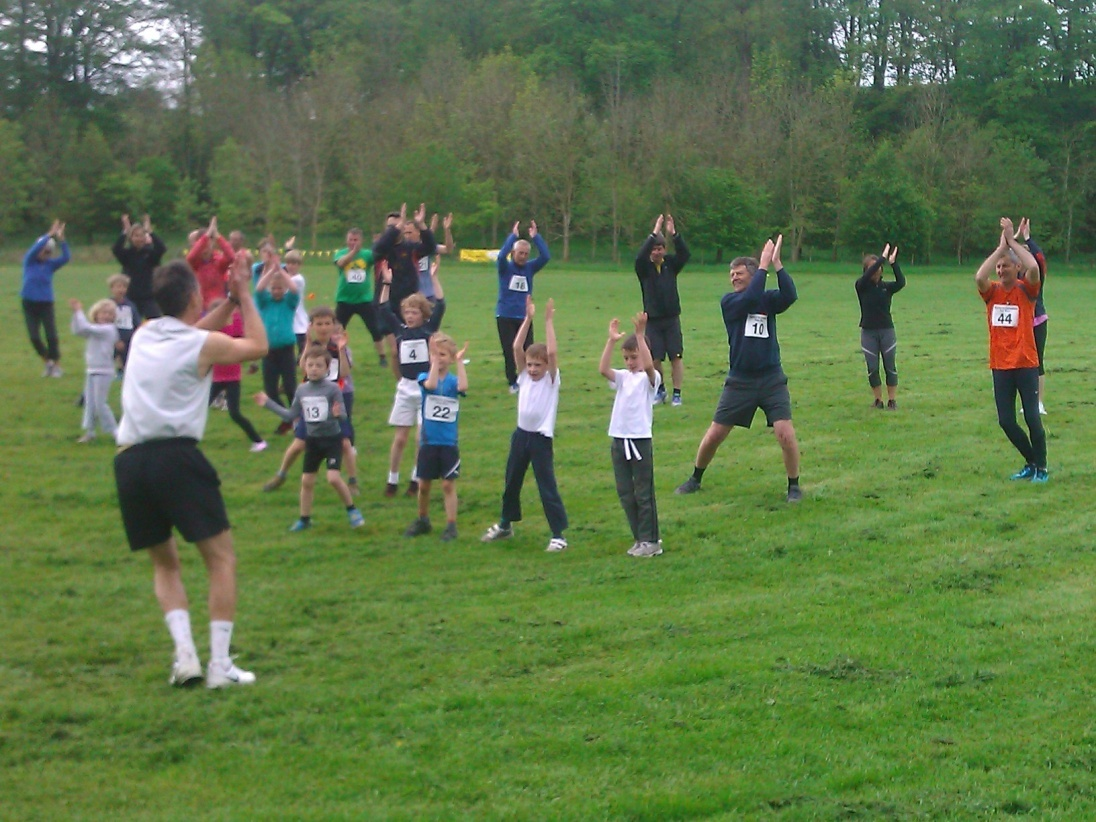 Runners taking part in the annual fun run in Burton-in-Lonsdale warm up with some lively aerobic routines