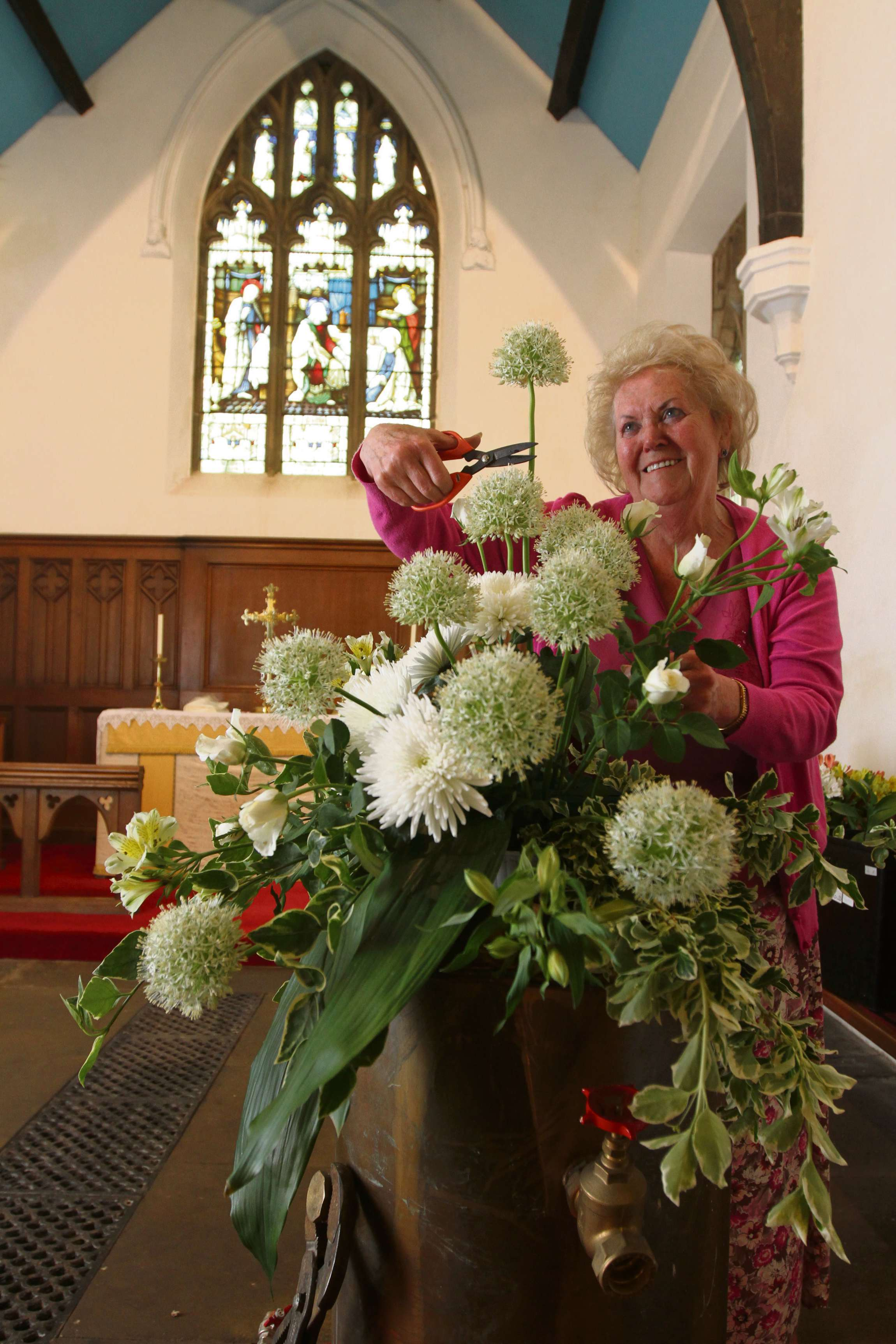 Eileen Proud puts the finishing touches to her display which is part of the flower festival held at Holy Trinty Church , Cowling. (6349008)