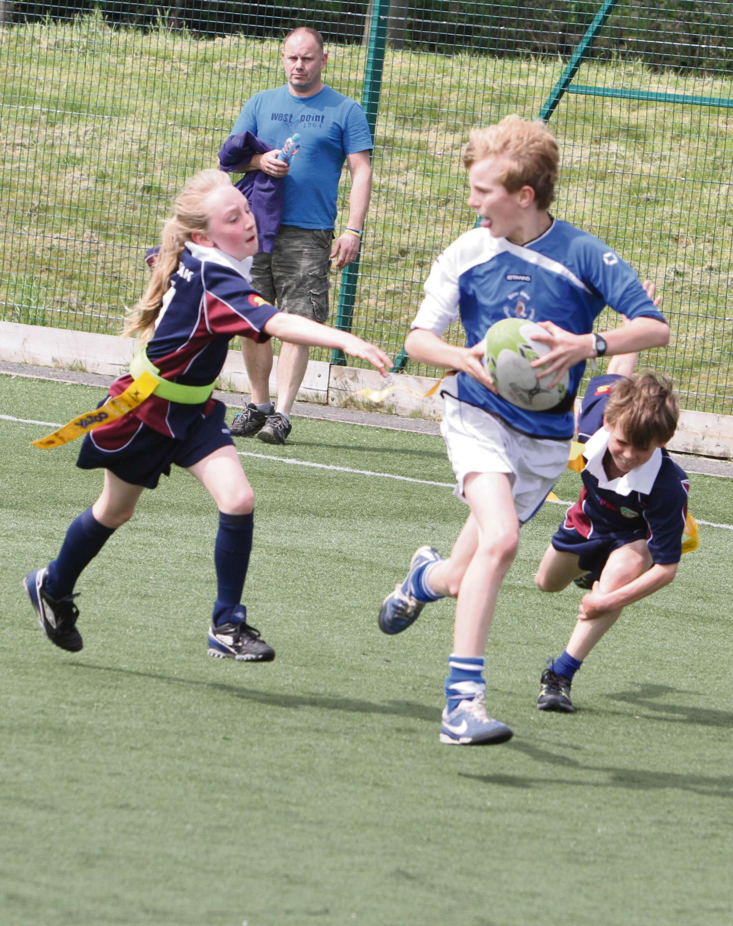 Primary school pupils take part in tag rugby contest