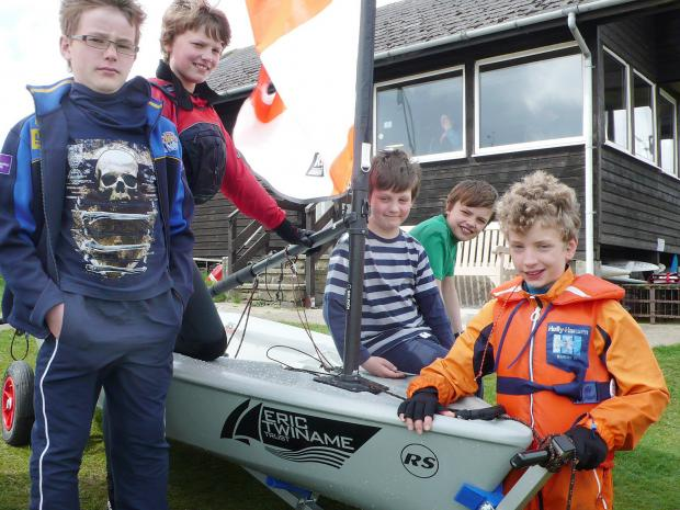 Craven Herald: Members of Craven Sailing Club reveal the latest addition to their fleet - a new RS Tera boat purchased with assistance from the Eric Twiname Trust. T (6243158)