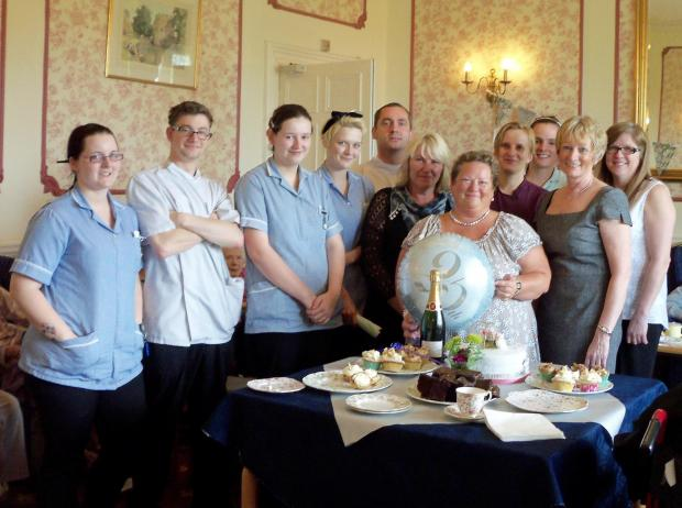 Lucy Richardson surrounded by members of staff at Anley Hall