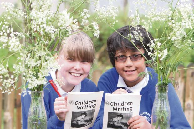 Craven Herald: Lothersdale Primary School pupils Amber Ward and Sebastian Ma'har  win prizes for their short stories  at Airedale Writers Circle. (6460055)