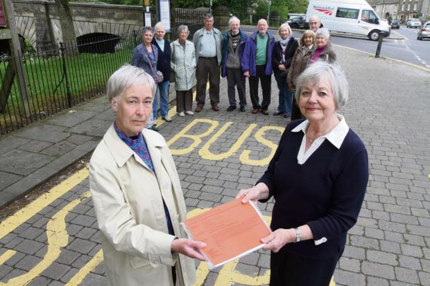 Residents of Gargrave hand over a petition with over 1200 signatures protesting against the withdrawing of the Bus service from Gargrave to Skipton. Picture shows Concerned resident Rachel Flynn with Councilor Shelagh Marshall and other protestors. (65740