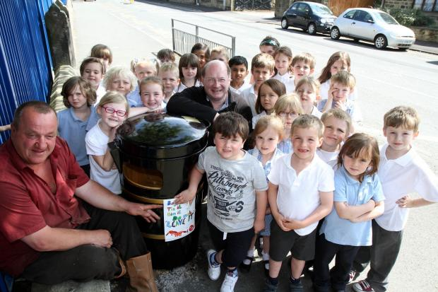 Silsden mayor Councillor Chris Atkinson, left, and district councillor Adrian Naylor join children from Aire View Infant School at one of the litter bins