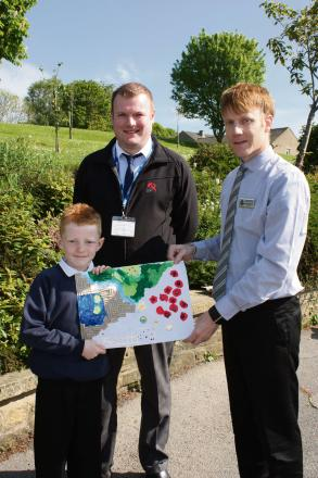 Greatwood School pupil Michael Pickering, runner up in the northern heat of the national Giving Nature a Home competition, pictured with a representative of JDP and headteacher Garry de Castro Morland