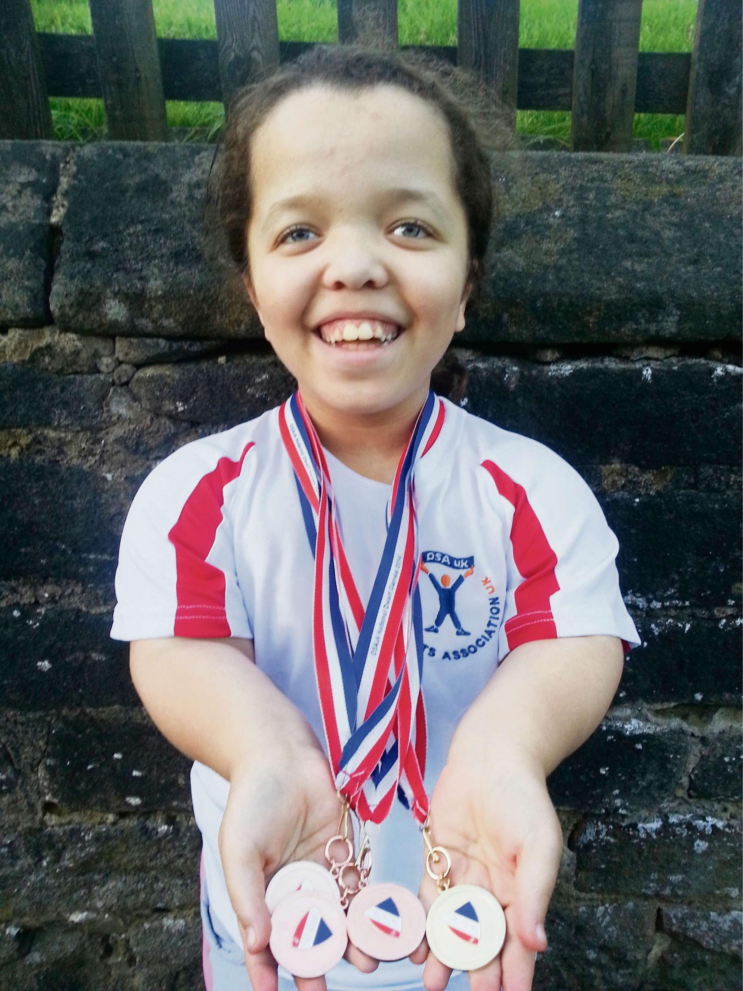 Savannah Troughton-Webb, aged ten of Addingham, who is  celebrating after returning from the Dwarf Sports Association UK competition with a haul of medals. (6711157)