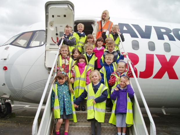 THEY'RE FLYING HIGH: Children from Coates Lane Primary School at Manchester Airport