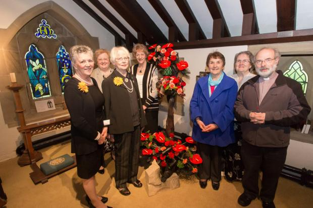St Mary's, Carleton, stages a flower festival on the theme of anniversaries. Pictured are Calendar Girls Chris Clancy and Beryl Bamforth, flower designers Ann Harding and Pat Daley, who selected the flower arrangers who created the breathtaking design