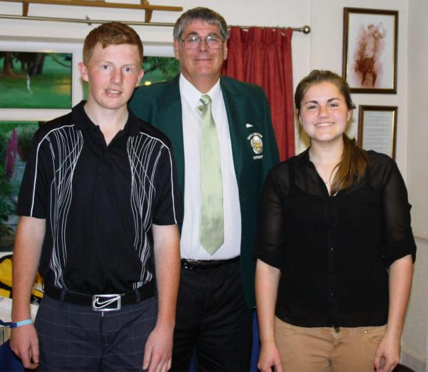 Captain, Brian Chapman with winner Brandon Cocker and Junior prize winner Emma Blades.