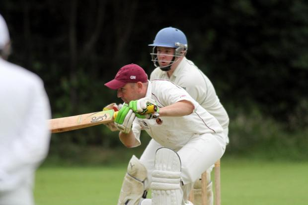 Craven Herald: Opener Wayne Exley  gets down to it for Ingrow in their victory at Glusburn