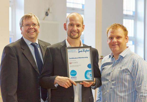 Sue Ryder regional fundraiser Andrew Wood awards Acorn Stairlifts' European Operations Manager, Nick Wilson (centre) and company secretary, Dave Belmont (left) with membership into the Manorlands Business Club.