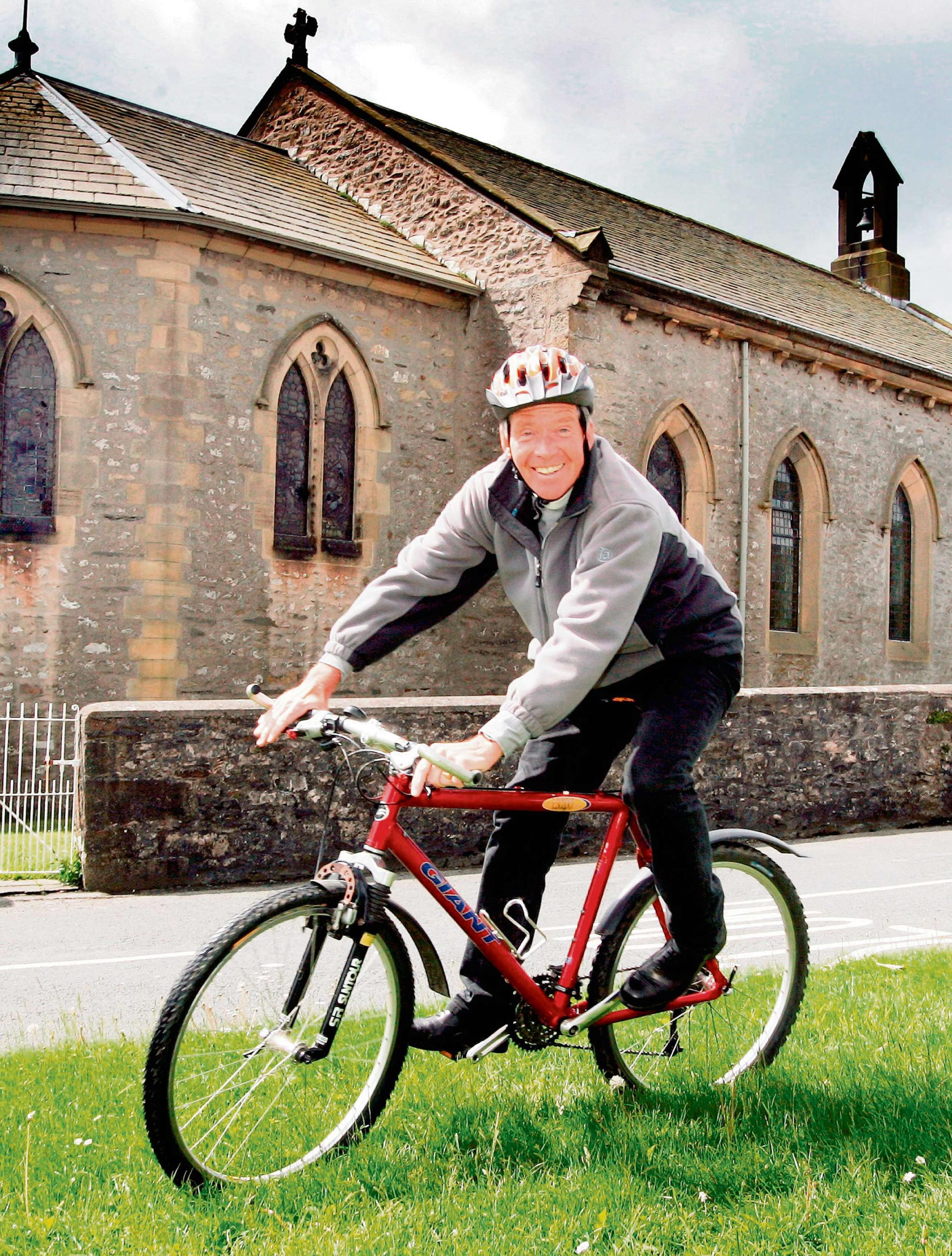 Vicar gets on his bike to raise money for church funds