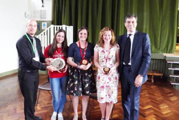 Skipton MP Julian Smith presents a plaque and individual awards to Upper Wharfedale School. Pictured are (from left to right) John Mitton (Student Voice Co-ordinator), Stephanie Roe, Kate Tulley, Harriet Ball and Julian Smith