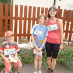 Craven Herald: Pictured after finishing the Tour de  Riddlesden fun run are, from left, Joshua, Zac and Elspeth Cansdale.