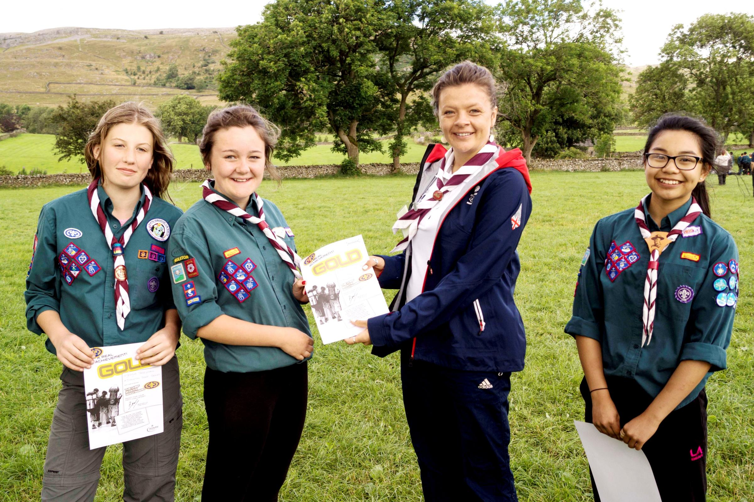Ingleton Scouts Georgia Tazzyman, Beth Dinsdale and Jeah Modar receiving their Chief Scout Gold Awards from Olympian, Emma Lonsdale