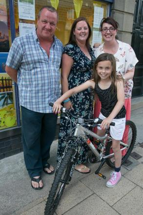 Hannah Griffiths with her new mountain bike, and Silsden mayor Chris Atkinson looking on
