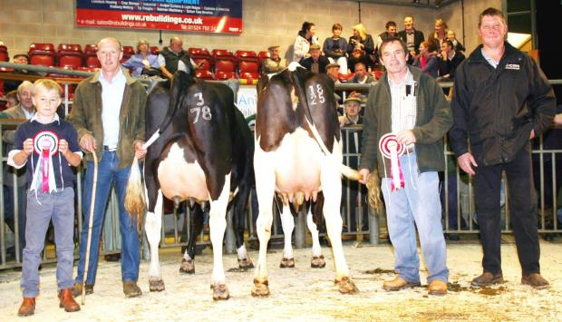 The Craven Dairy Auction main August show principles are pictured in the Skipton ring. From left are 11-year-old son John Simpson, his uncle and show champion Robert Swires, reserve champion Brian Moorhouse and judge Angus Dean.