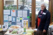 Kathleen Sutton, who is a member of the Dyneley House Patient Participation Group, looks at the smoothie and kebab display