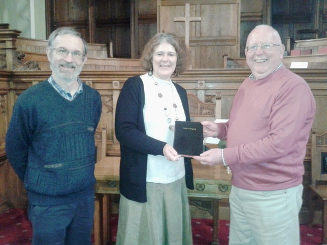 Tim and Maggie Gaved present a bible to David Charlton from St Andrew's Church, Skipton