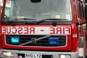 Pensioner found dead after Sutton house fire