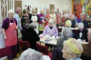 Glusburn Luncheon Club diners pay tribute to the team of volunteers who have provided meals for many years.
