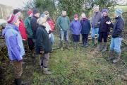Caroline Moorhouse makes a point, while discussing trees with Mark Hewitt (YDNPA) and Parish Wildlife Project volunteers from across Craven. Picture by Rae Lonsdale.