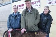 Phil Coleman, of sponsors Forfarmers, with Phillip Summers and his champion calf, and judge Samantha Asquith