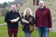 Lee Grice, of Craven Poultry Keepers Association, with judge Jacqui Moore, and champion Edward Boothman, with his winning pair of White Call ducks