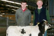 Fred Houseman is pictured right with one of his £600 Skipton rearing calves, joined by buyer Charles Mason