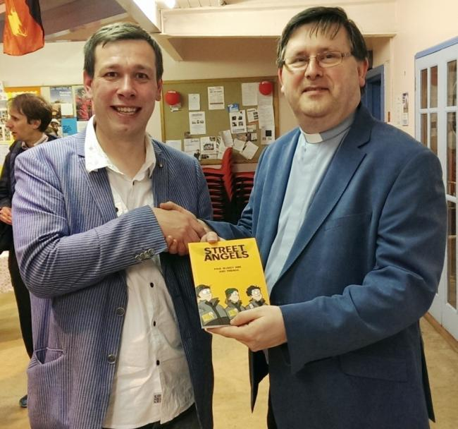 Paul Blakey presents a copy of his book to the Rev Richard Atkinson. Picture by Brian Appleby
