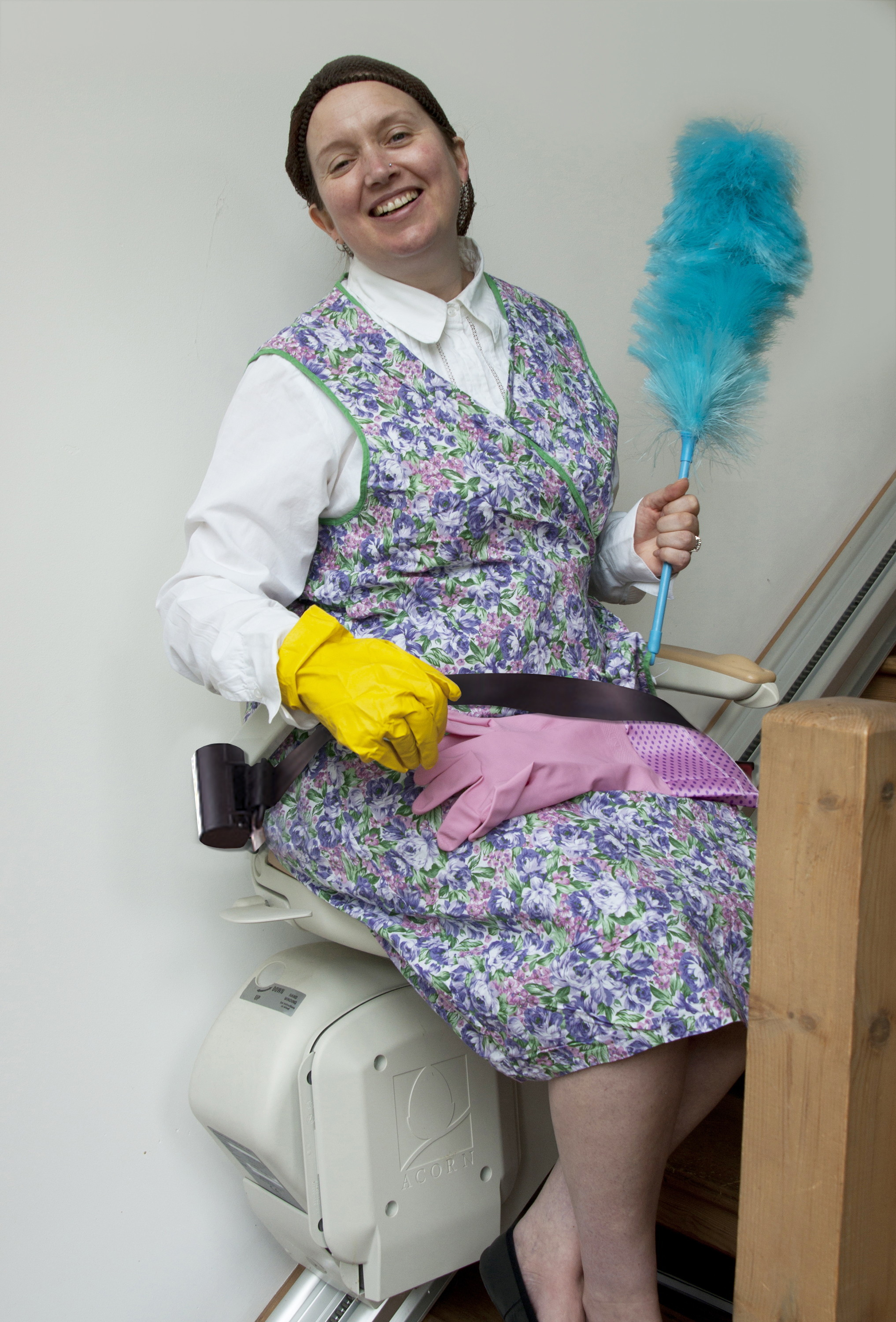 Nadine Darnley as Mrs Overall on an Acorn stairlift in the latest production of Acorn Antiques the Musical