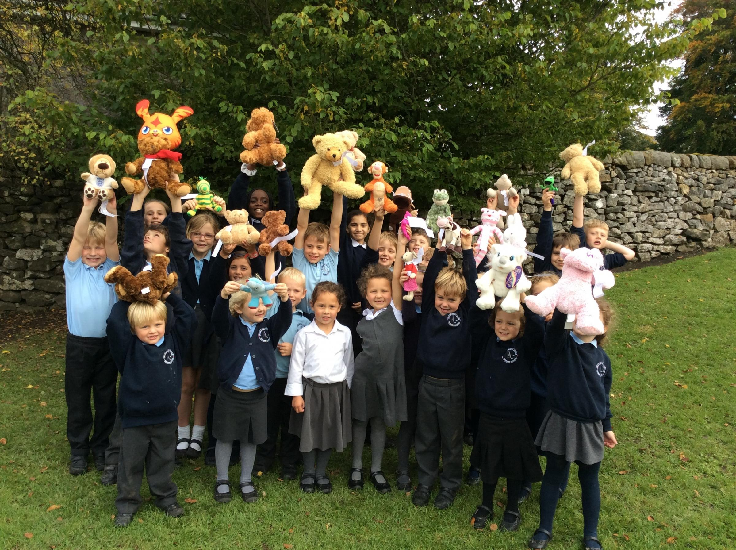 Cracoe and Rylstone Primary School pupils celebrate their success in raising cash to help Syrian refugee families in 'Project Paddington.'