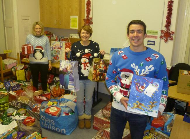 Young Carer workers Hettie Flynn, Laura Frith and James Woodhead-Dixon prepare the gifts and hampers
