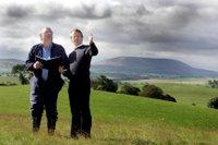 David Starkins of EnergieKontor, shows tenant farmer John Bancroft the site of the proposed wind farm