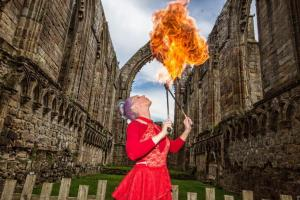 Craven Herald: The beautiful surroundings of the Priory Church at Bolton Abbey provided a stunning setting for a family event with story-telling and a spectacular fire artist.