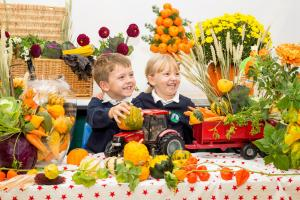 Craven Herald: Cowling Community Primary School pupils William and Jessica Cluny have no excuse not to eat their greens – their dad delivers fruit and vegetables by the van-load to their school!