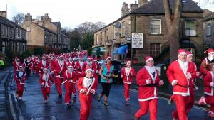 Craven Herald: A SEA of red and white swamped Skipton on Sunday when hundreds of Father Christmases converged on Aireville Park to take on the Santa Run. 