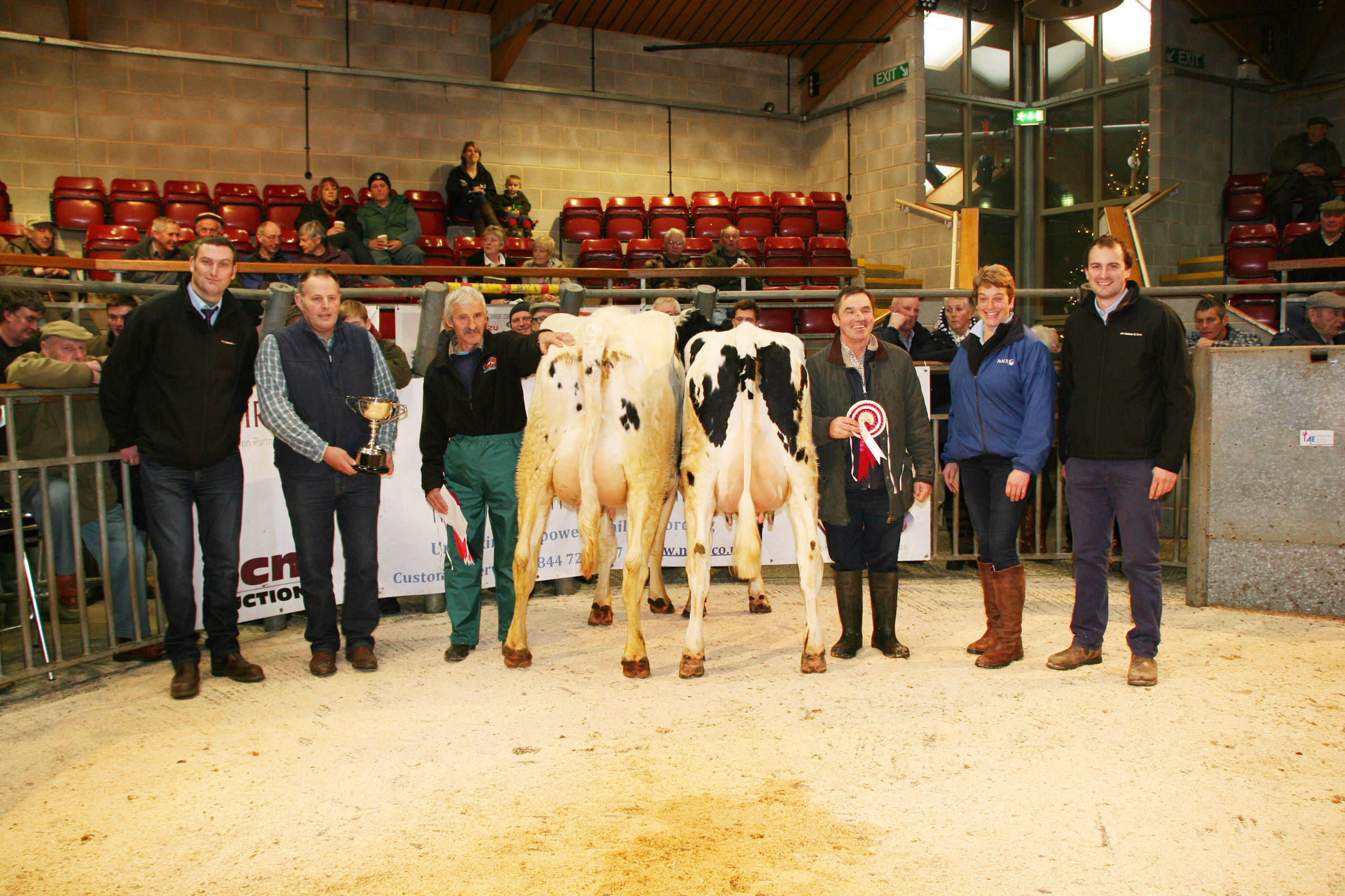 ): Pictured with the frontrunners at Skipton's Christmas Craven Dairy Auction are, from left, PV Dobson's William Bell, judge David Hall, champion Robert Crisp, reserve champion Brian Moorhouse, NMR's Helen Whittaker and Dobson's Paul Taylor