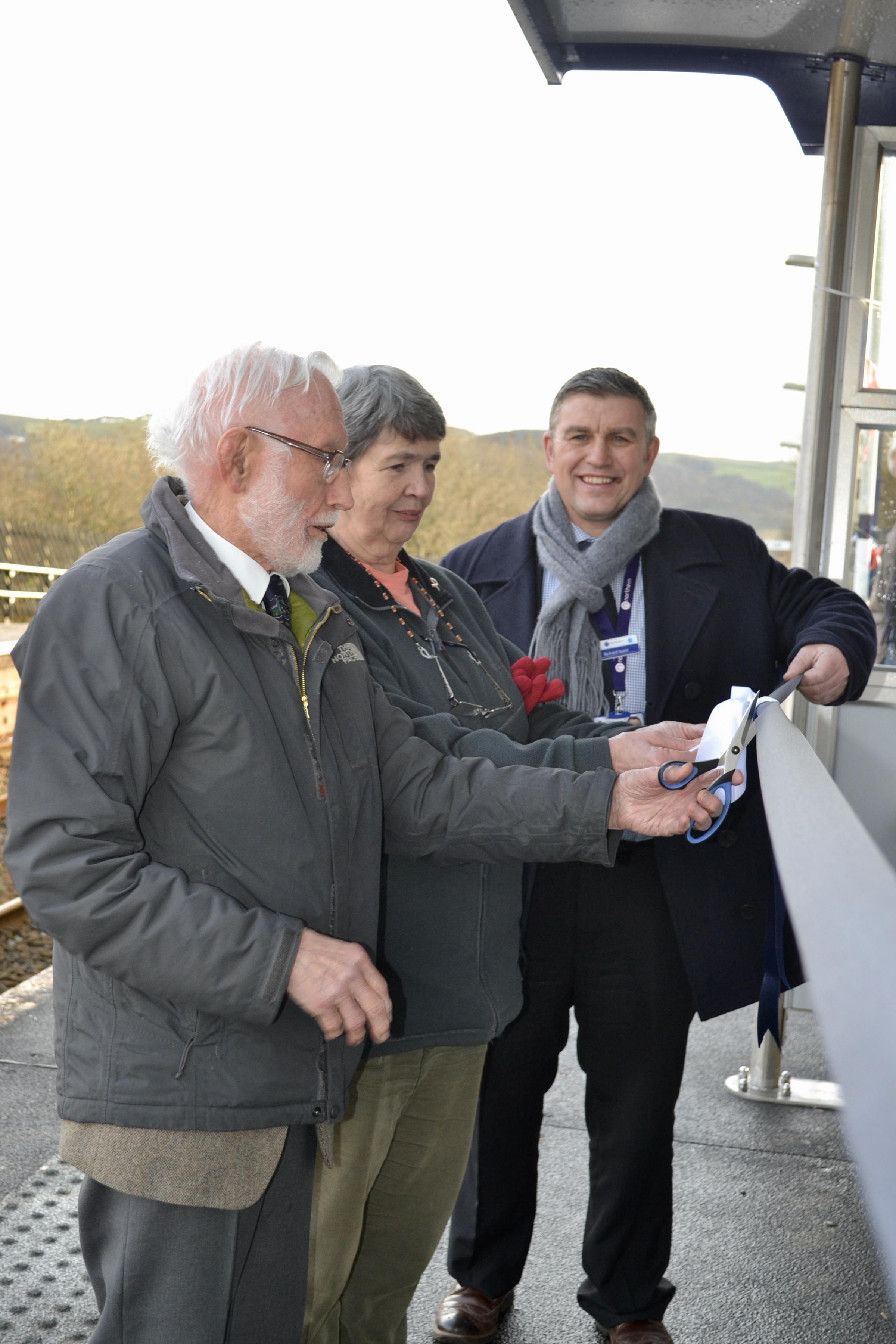 Getting out of the rain - from left: John Bearpark, president, Lancaster and Skipton Rail User Group; Councillor Margaret Airey, Giggleswick Parish Council and Richard Isaac, Community and Sustainability Manager, Northern, (Arriva Rail North Ltd). Picture