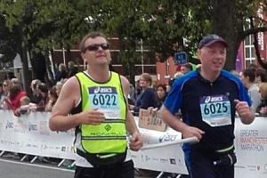 From left, Richard Thompson and Mike Spence running in the Manchester Marathon