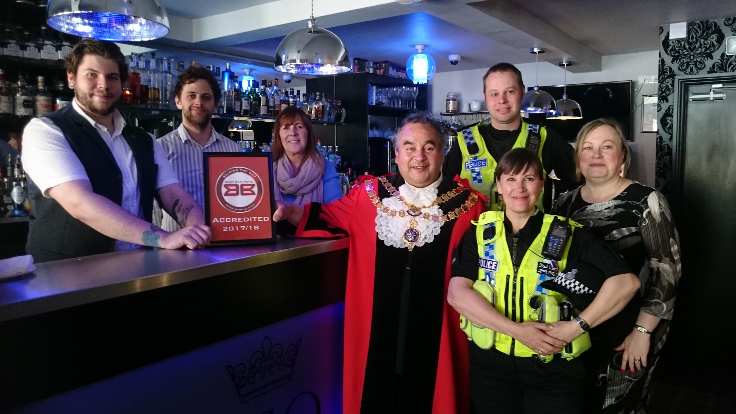 From left, Tom Venning, general manager; Nicholas Smout, assistant manager; Lorraine Forshaw, owner; former Mayor of Skipton Cllr Martin Emmerson; PC Jonathan Stubbs; PC Victoria Brook; Geraldine Thompson, Skipton BID VSQ Skipton