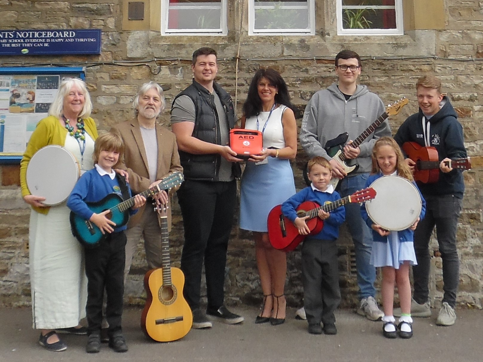 Teaching Assistant Pam Windle and Graham Windle; School Manager, Tracy Briggs; Will Collins, George Collins and Will Richmond from Shrymp Inc.; and three pupils from the after school Rock Club - Jake White, Jacob Lambert and Ellie Close.