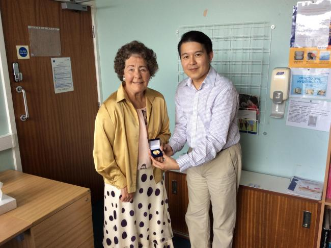 Enid being presented with her medal by Dr Thet Koko at Airedale General Hospital.